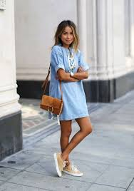 A Chambray Dress With Lacing Neutral Sneakers And An Ocher Crossbody Bag