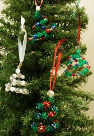 Easy Christmas Crafts Spiral Beaded Ornament Four Finished Ornaments Hanging On Tree