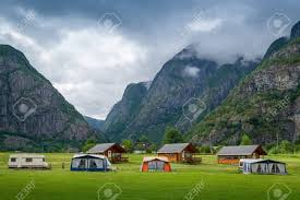 100 Houses In Norway Norwegian Camping Houses At Green Grass Field Under The High