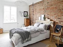 Vitnage Inspired Bedroom Is Accentuated With An Exposed Brick Wall