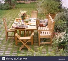 Wooden Bench And Chairs At Table Set For Lunch On Patio In French ... Hill Country Rectangular Table With Four Side Chairs And One Bench Kitchen Seat Fresh Ding Country Home Farm Table And Chair Set Just Fine Tables Wooden Cost Room Leons With Style Sets Home Interior Blog 6 Pc Farmhouse For Shabby Chic Pine Louis Xvi Benches Another Farmhouse Ding Room Set Bench The History Of Gbvims Makeover