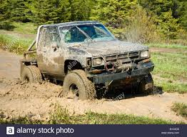 Muddy Truck 4x4ing Through A Muddy Road Stock Photo, Royalty Free ... Rc Adventures Muddy Monster Truck Smoke Show Chocolate Milk A Pickup Truck Stock Image Image Of Park Road Parked 37865223 The News Big Guns Ammo Can Mega Feature 2017 Pickup The Year Day Five Ptoty17 Photo 2 Stickers By Kriss53 Redbubble National Ffa Week Big Success At Wayne County High School Tyre Wheel Photo Dirty Grungy 931508 Turbo 60 Chevy Mud Truck Youtube Trucks Of The South Go Deep Unbelievable Bottoms 5500 Bounty Hole Finally Gets Beat