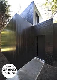 Cheap Shed Cladding Ideas by Black Siberian Larch Cladding On Grand Designs