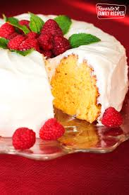 Lemon Bundt Cake Topped With Raspberries A Slice Cut Out