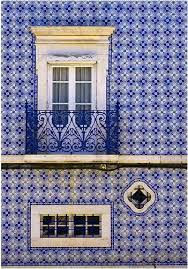blue white tiles covering the wall of a house in portugal