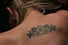 Small Hawaiian Flowers Tattoo On Upper Back