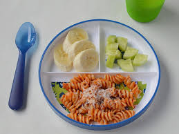 A Three Sectioned Plate With Tomato And Cheese Pasta Banana Chunks Cubed Cucumber