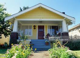 Style Home by Yellow Bungalow Style House With Garden Exterior View Stock Photo