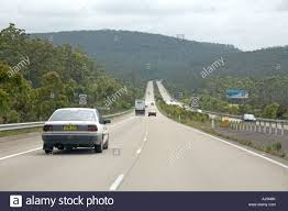 100 Pacific Road Cars On Highway Motorway Road Near Taree In New South Wales