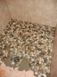instead of using tile in bathroom she decided to use pebbles