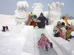 Children Playing Cheerfully On A Slide At The Asahikawa Winter Festival Venue