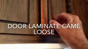 Thermofoil Cabinet Doors Peeling by How To Reglue Laminate On Cabinet Door Youtube