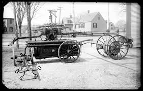 Old Fire Apparatus With Hose Or Hand Pump