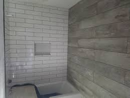 wood grain tile vs real reclaimed wood accent walls