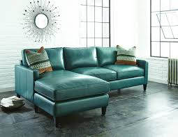 Amazing Navy Blue Leather Sectional Sofa With Concrete Flooring And Starburst Wall Mirror Also French Window For Rustic Living Room Design Ideas