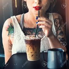 Hipster Woman Drinking Iced Coffee Concept Stock Photo