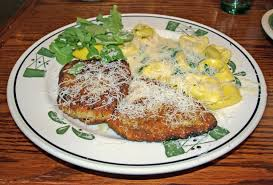 Breaded Chicken Milanese with Tortellini and Arugula in Cr…