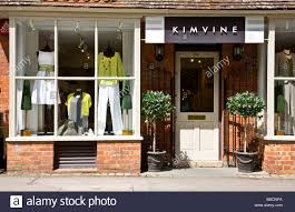 Window Display Of An Upmarket Ladies Fashion Clothing Shop Or Boutique