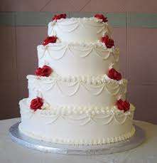 Classic Wedding Cakes · 7 Shown in with Red Butter Cream Roses
