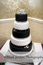 "Classic black and white wedding cake with large ""diamonds"""