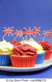 English Theme Red White And Blue Cupcakes With Great Britain Union Jack Flags For National Party Celebrations Close Up Vertical
