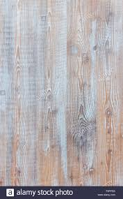 Aged Wooden Background Of Weathered Distressed Rustic Wood Boards With Faded Light Blue Paint Showing Brown Woodgrain Texture
