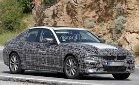 BMW 3 Series Test Mule With Electric Vehicle Stickers And A Closed Off Front Grille Image Motor1