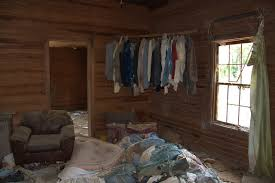 Screven County GA Abandoned House Interior Bare Walls Curtain Clothes Hanging In Corner Photograph Copyright Brian