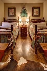 Rustic And Southwestern Styles Combine Expertly In This Lodge Style Bedroom A Cowhide Rug
