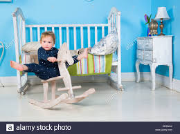Child Play With A Wooden Rocking Toy Horse Pony Stock Photo ... Antique Wood Rocking Chairantique Chair Australia Wooden Background Png Download 922 Free Transparent Infant Shing Kids Animal Horses Multi Functional Pink Plush Pony Horse Ride On Toy By Happy Trails Lobbyist Rocker For Architonic Rockin Rider Animated Cheval Bascule Rose Products Baby Decor My Little Pony Rocking Chair Personalized Two Sisters Plust Ponies Prancing Book Caddy Puzzle Set Little Horses Horse Riding Stable Farm Horseback Rknrd305 Home Plastic Horsebaby Suitable 1