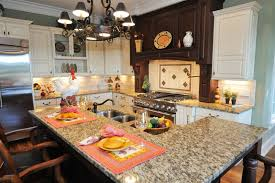 Compact Richly Detailed Kitchen Holds This Two Tiered Island With Built In Sink