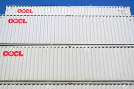100 Shipping Containers 40 OOCL Ft Intermodal Containers Stacked In Harbor OOCL Is A
