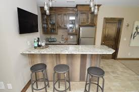 Attractive Home Bar Design With Oak Wood Cabinet And White Galaxy Granite Countertop Plus Industrial Metal