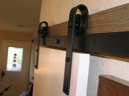 Agave Ironworks Barn Door Rolling Hardware Kit & Reviews | Wayfair Rolling Barn Doors Shop Stainless Glide 7875in Steel Interior Door Roller Kit Everbilt Sliding Hdware Tractor Supply National Decorative Small Ideas Sweet John Robinson House Decor Bypass Diy Tutorial Iu0027d Use Reclaimed Witherow Top Mount Inside Images Design Fniture Pocket Hinges Installation