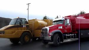 Caterpillar 740 Articualted Water And 730 Fuel Lube Truck Plus Mack ...
