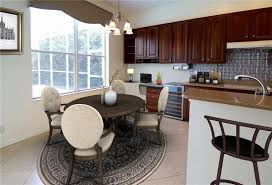 Dining Are Found As You Walk Through The Front Door Large Family Room Off Kitchen With Sliding Doors To Covered Patio And HEATED PRIVATE Pool SPA