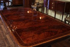 Mahogany Dining Table Shown Here Under Dim Warm Lighting