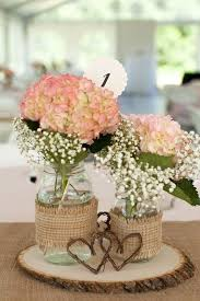 Mason Jars Wrapped With Burlap And Floral Arrangements Twig Hearts
