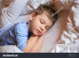 boy sleeping pajamas on white bed stock photo 401840842 shutterstock