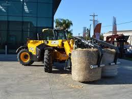 100 Jm Truck Sales JM Agri TR8 Double Arm Bale Grab PICKLES AUCTIONS Trucksalescomau
