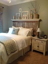 Photo 1 Of 9 Bedroom Rustic King Size Master Design With Unusual Reclaimed Wood Headboard Under Floating Display