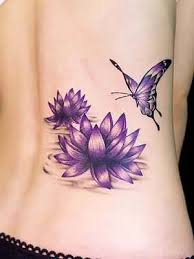 Women Lower Back Cover Up With Beautiful Purple Flowers And Nice Looking Flying Butterfly Tattoo