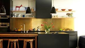 A Brass Splashback Adds Warmth And Glow To This Kitchen Which Features Stained Black