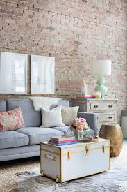 Exciting Living Room Decor Ideas 2015 On A Budget Wall Brick Light Grey Couch White Golden Border Chest Table Brown Rug