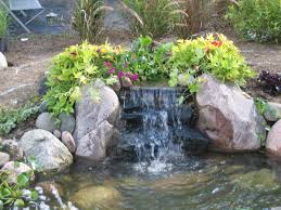 Outdoor And Patio: Beautiful Flowers And Rock Edge Arrangement ... Diy Backyard Waterfall Outdoor Fniture Design And Ideas Fantastic Waterfall And Natural Plants Around Pool Like Pond Build A Backyard Family Hdyman Building A Video Ing Easy Waterfalls Process At Blessings Part 1 Poofing The Pillows Back Plans Small Kits Homemade Making Safe With The Latest Home Ponds Call For Free Estimate Of 18 Best Diy Designs 2017 Koi By Hand Youtube Backyards Wonderful How To For