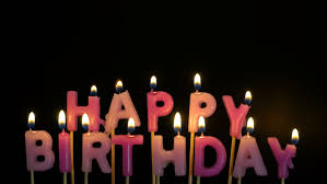 Footage colorful burning candles set on black background Happy Birthday candles 4K stock footage