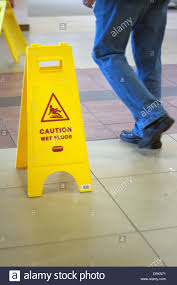 Caution Wet Floor Banana Sign by Caution Wet Floor Signs In A Public Building Stock Photo Royalty