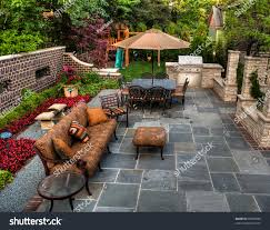 Backyard Patio Garden Stock Photo 36009838 - Shutterstock Sweet Images About Patio Rebuild Ideas On Backyards Kid Toystorage Designing A Around Fire Pit Diy 16 Inspirational Backyard Landscape Designs As Seen From Above 66 And Outdoor Fireplace Network Blog Made Minnesota Paver Retaing Walls Southview Design Backyardpatios Flagstone With Stone 148 Best Images On Pinterest Living Patios 19 Inspiring And Bathroom Sink Legs Creating Driveways Pathways Pacific Brothers Concrete Living Archives Arstic