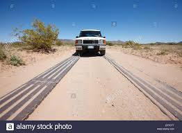 Metal Tracks Used To Reinforce Eroding Dirt Road Heavily Used By U.S ... New And Used Ford Dealer Near Tucson Oracle Inc Phoenix Arizona Bus Trailer Truck Service Parts Auto St Louis Area Buick Gmc Laura Freeway Chevrolet A In Chandler Wraps Az 3m Certified Graphics Installation Facility Peterbilt Dump Trucks In For Sale On For Az 1920 Car Reviews Ray Bobs Salvage Velocity Centers Dealerships California Nevada Cars Mesa Scottsdale Freedom Sales Kingman Ubers Selfdriving Trucks Have Started Hauling Freight Ars Technica