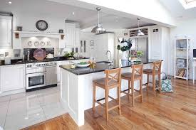 tile to wood floor transition spaces traditional with kitchen